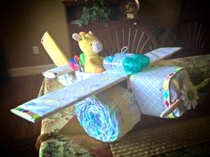 This airplane diaper cake turned out great! The tutorial I found on Pinterest made it easy to make!