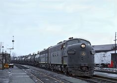 A grimy Baltimore & Ohio ( leads tankers through Martinsburg, West Virginia (longtime home of a major shops complex) along the Cumberland Division on March Baltimore And Ohio Railroad, Railroad Pictures, Rolling Stock, West Virginia, Mississippi, Division, Trains, March, Shops