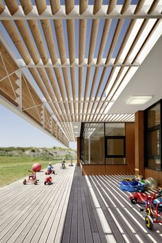Neufeld an der Leitha Kindergarten,by Solid Architecture.  A beautiful example of how sunshading should work.