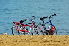 two bicycles on a beach