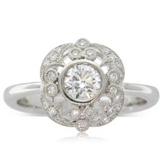 18ct white gold .50ct diamond filigree ring, a beautiful occasional or perfect engagement  ring
