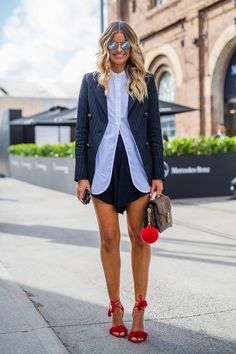 Lindy Klim wearing Tome, shoes by Yves Saint Laurent, bag by Scanlan Theodore and Celine sunglasses.