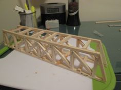 This instruction set will teach you how to design and construct your own bridge made out of balsa wood. This is a fun, intriguing project that will entertain an. Popsicle Stick Bridges, Space Truss, Engineering Classes, Engineering Challenges, Bridge Model, Wood Truss, Model Railway Track Plans, Bridge Construction, Man Crafts