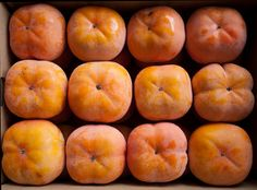 Although there are by some counts around 1,000 different varieties of persimmons in Japan alone, they can be broadly divided into two types: sweet (amagaki) and bitter or astringent (shibugaki). The ones in the photo are the sweet kind, which can be eaten as is as soon as they are ripe. They have firm flesh, and are simply sliced.
