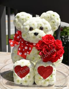 This FlowerToy® bear is made from fresh flowers. Order online @ www.flowertoy.com We ship nationwide
