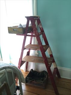 A cat tree made out if an old wooden ladder. This could also be used as a book or a plant shelf.