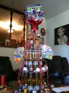 Made a corona tower for my man... Added party poppers, lotto tickets, mini liquor bottles, dice, poker chips, a pic of us up top, beer salt and a bottle of patron in the center of the bottom layer