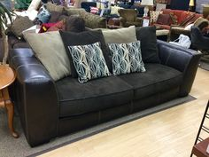 """FIND FURNITURE THAT FITS YOUR STYLE AT NEW USES: Comfy Pillow Back Sofa measuring 90"""" W, 37.5"""" D and comes with $10 back in rewards- $240."""