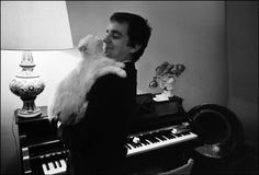 Actor Dudley Moore snuggling and smiling with a feline friend!