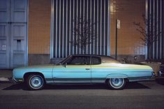 <em>Silver Fish, Chevrolet Impala Custom Coupe, in front of Con Edison substation, 1975.</em>