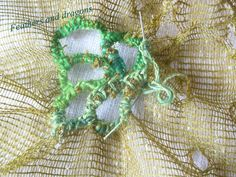 """Making holes in a netting fabric and buttonhole stitching. Inspired by the book """"Stitch and structure"""" by Jean Draper"""
