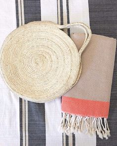 cotton Foutas // Adding colour doesn't need to be over done. See how effective the simple pop of orange has with a neutral tone? Neutral Tones, Living Room Interior, Straw Bag, Interiors, Colour, Pop, Photo And Video, Orange, Simple