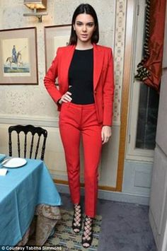 Kendall Jenner struck gold once again during Paris Fashion Week in this stylish red pantsuit while attending a party for shoe designer Tabitha Simmons at Caviar Kaspia on Thursday