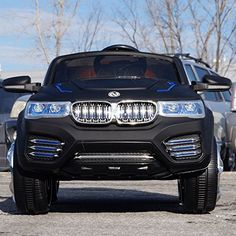12v Ride on Car BMW X5 Style , Toy for Kids, Boys and Girls Music, Opening Doors, Real Tires Lights and Remote Control- Matte Black Paint