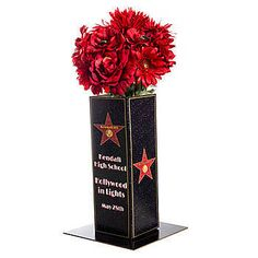 Choose this Walk of Fame Personalized Centerpiece featuring a black background with a red star outlined in gold. Each centerpiece measures 14 inches high.  Being able to Personalize this items means that you can write whatever you like on it from Birthday Bash to Prom.  Name your Event by Personalizing it!