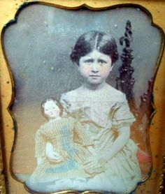 Portland Maine Circa 1850 Quarter plate daguerreotype of young girl approximately 10 years old holding a covered wagon style china head doll.