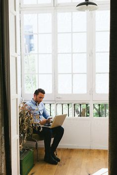 Entrepreneur man working at his modern office. by BONNINSTUDIO