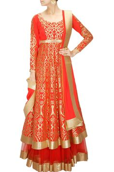 This red lehenga shirt is made in gorgette fabric having golden colour applique work. Bottom lehenga of this anarkali lehenga set is in net fabric with lurex bo