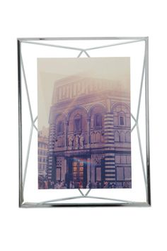 """Add new dimension to your photo displays with this prismatic 5x7"""" chrome wire frame in which a photo floats between two panes of glass. Can alternately sit on the desk or be hung on the wall.  Measures 7 x 9 x 3"""" (17.8 x 22.9 x 7.6 cm)  Chrome 5x7 Frame by Umbra. Home & Gifts - Home Decor - Frames Washington"""