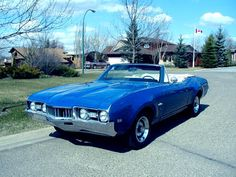 my first car, '68 cutlass supreme convertible.