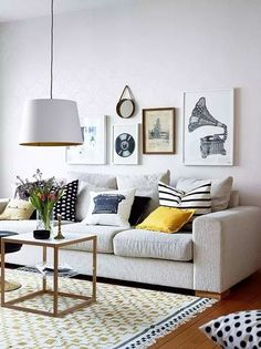 Grey couch + pops of color (pillows, rug)