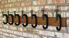 I like this idea, 'cause i can hang two hats on each clamp.  What do you think? C clamps are kinda expensive...got any ideas of something we can repurpose to serve the same idea?  Maybe something a little less industrial looking for the bedroom?