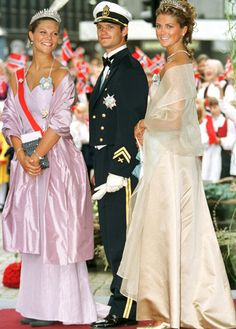 Crown Princess Victoria of Sweden, Prince Carl Philip and Princess Madeleine outside Oslo Cathedral after the wedding ceremony; wedding of Crown Prince Haakon of Norway and ms. Mette-Marit Tjessem Høiby, August 25th 2001