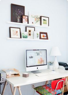 prints/photos above desk.