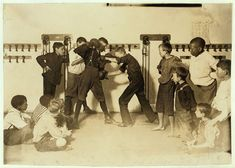 """The """"Manly art of self-defense"""" Newsboys' Protective Association. Location: Cincinnati, Ohio. 1908 August. Library of Congress."""