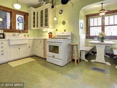 Cottage Kitchen with Green marmoleum g3 vivace, World imports luray 1 school houselight pendant, Breakfast nook, L-shaped