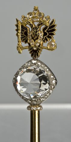 The part of the scepter of Russian Empress Catherine II. The head of the scepter is crowned by one of the biggest diamonds in the world, Orlov that was presented to Catherine (Ekaterina, in Russian) by her favorite Grigori Orlov. Some scholars think that Catherine II only used Grigori as a buyer of the diamond she wanted for herself ~