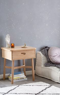 Make astrology a part of your home decor, too. This starry wallpaper is inspired by horoscope constellations, and since soft lilac is a super on-trend colour, you know your space will be stylish. The delicate mystical design is a mesmerising idea for a reading and relaxation nook. Candles and comfy throws are a must. Witchy Wallpaper, Forest Wallpaper, Daybed In Living Room, Childrens Shop, Meditation Corner, World Map Wallpaper, Spiritual Decor, Crystal Decor, Fashion Room