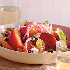 Summer peach and tomato salad. Just bought the season's first peaches at the farmers market and can't wait to try this.