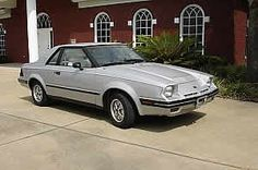 The first brand new car I bought ... 1984 Ford EXP Silver Hatch Back...