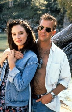 Madeleine Stowe is held by Kevin Costner in a scene from the film 'Revenge' 1990