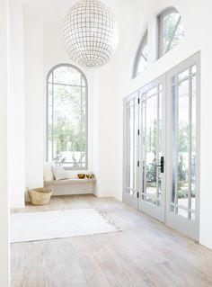 love the whitewashed color scheme & amazing lighting this entryway gets