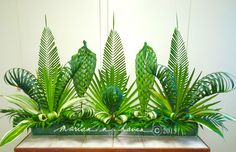 My altar centerpiece for Palm Sunday 2015, at St. Dunstan Catholic Church, Millbrae. One can make a good foliage arrangement like this just by using variances in color, texture, height, pattern, & design. ;-) --MARIAN N. HAVEN