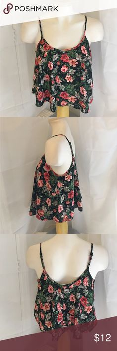 "Black floral camisole stop size M Black floral camisole top by Ambiance Apparel has adjustable straps and flared bottom hem. Length 19"", bust 38"".  100% polyester, hand wash. New! ambiance apparel Tops Camisoles"