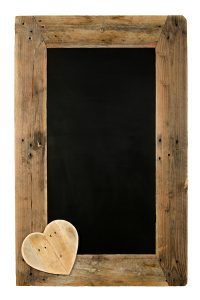 Chalkboard restaurant menu board reclaimed pallet wooden frame and hearts isolated on white with copy space