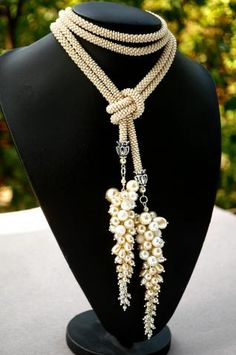 Gorgeous beaded rope and pearls necklace. Would also do just the tassel parts as dramatic earrings