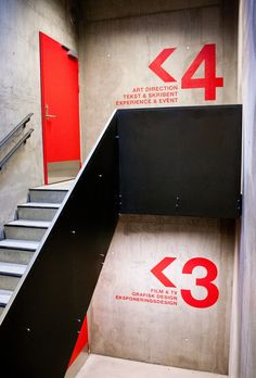 Smart use of typography in typically boring stairwell.  Perfect example of graphic meets interior design.