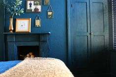 Blue walls and painted fireplace bedroom