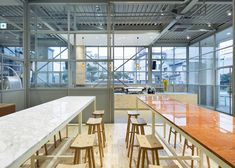Japanese studio Schemata Architects has converted an old warehouse in Tokyo into a cafe and roastery for Blue Bottle