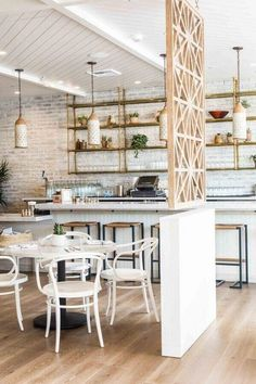 dividing wall idea wooden screen divider // Cafe Gratitude in downtown LA, Wendy Haworth design Cafe Interior Design, Commercial Interior Design, Cafe Design, Commercial Interiors, Bakery Shop Interior, Restaurant Design, Deco Restaurant, Cafe Gratitude, Cafe Shop