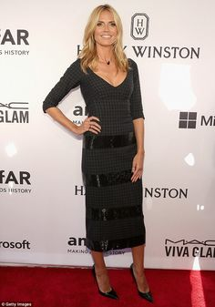 Covered up: Heidi Klum opted to keep most of her svelte shape under wraps as she attended ...