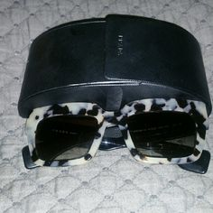 Authentic PRADA Sunglasses with CASE Beautiful gray scale tortoise sunglasses. No scratches,  comes with prada case. Prada Accessories Sunglasses