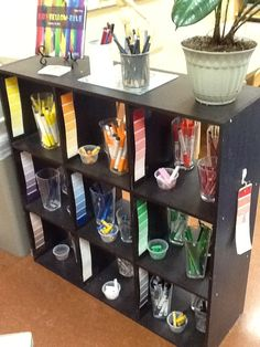 The Power of Art - Journey Into Early Childhood I love the presentation and visual organization of the materials. The black shelves allow the colors to appear vibrant and easily distinguishable.  The paint chips  are a wonderful way to show hues and gradient... good idea!