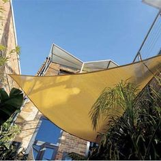 Reclaim a too-hot-for-comfort patio by shielding it from the sun with a sleek shade sail. Coolaroo's 12-foot Triangle Sail sun shade, about $30; walmart.com