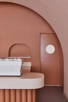Melbourne-based interior design studio Biasol used earthy hues and stylised architectural motifs to create a destination inspired by Wes Anderson's symmetry and nostalgic colour palette.