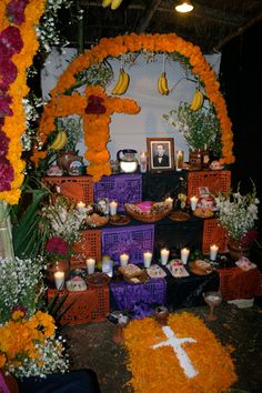 Another Alter honoring the departed where you can clearly see the photo of the departed, candles, food offerings and lots of flowers.